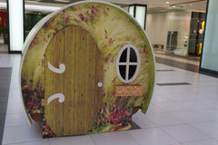 Playhouse in a mall. Funny wooden children playhouse in a shopping mall Stock Photo
