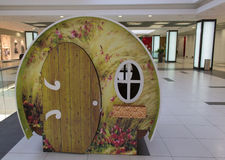 Playhouse in a mall. Funny wooden children playhouse in a shopping mall Stock Image