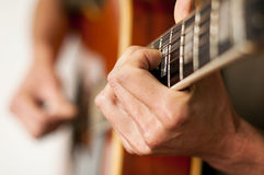 Playing A Twelve String Acoustic Guitar Stock Photo