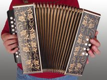 Playing the accordion. Isolated musician with squeezebox Royalty Free Stock Photo