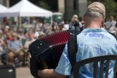 Playing accordion. Public listening accordion player outdoor in the Riverside Park, NYC during First accordion festival Stock Images