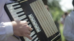 Playing in Accordion stock video footage