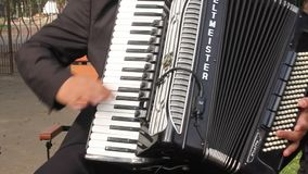 Playing at the accordion stock footage