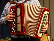 Man playing accordion, hands. Playing the accordion, you can see a lot of buttons and hands of a senior royalty free stock photo