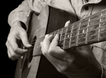 Playing acoustic guitar royalty free stock image