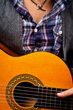 Playing acoustic guitar Stock Photography