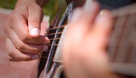 Playing acoustic guitar. Great shot detail of a guitarist hands royalty free stock images