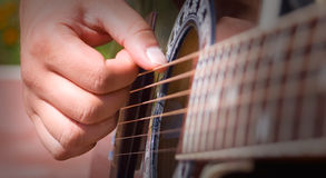 Playing acoustic guitar. Great shot detail of a guitarist hands Royalty Free Stock Photo