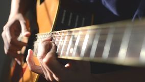 Playing on acoustic guitar. Close up stock footage