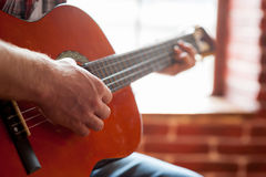 Playing acoustic guitar. Royalty Free Stock Photos