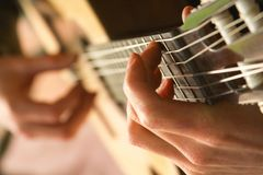 Playing on acoustic guitar royalty free stock photos