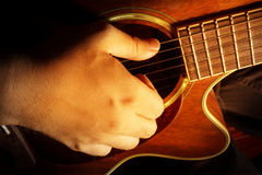 Playing acoustic guitar,guitarist or musician Royalty Free Stock Photography