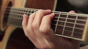 Playing on the acoustic guitar. Musical instrument with guitarist hands stock video