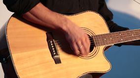 Playing On The Acoustic Guitar. Musical Instrument With Guitarist Hands. Musician In Night Club. Shallow depth of the field, 59. 94 fps stock footage