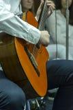 Playing acoustic guitar Stock Photos