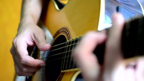 Playing on acoustic guitar. Close up stock video