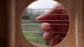 Playing acoustic guitar, slow motion stock footage