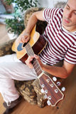 Playing acoustic guitar Stock Images