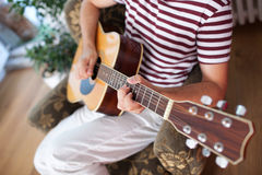 Playing acoustic guitar Royalty Free Stock Images