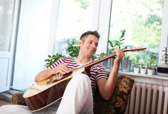 Playing acoustic guitar Royalty Free Stock Photo
