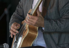 Playing Acoustic Slide Guitar Stock Photo