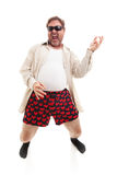 Playing Air Guitar. Funny photo of a middle aged man playing air guitar in his underwear.  Full body isolated on white Stock Photography