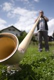 Playing the alphorn Royalty Free Stock Images