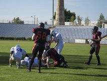 Playing American football at the stadium. stock image