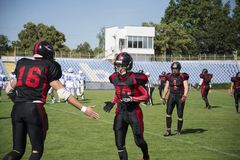 Playing American football at the stadium. stock photo