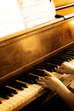 Playing Antique Piano Royalty Free Stock Photo