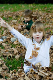 Playing in the autumn leaves Stock Image