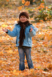 Playing in autumn park Royalty Free Stock Images