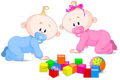 Playing babies. Two cute playing babies with cubes Royalty Free Stock Image