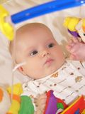 Playing baby. Portrait of playing baby girl Stock Photo
