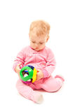 Playing baby. Isolated little cute baby playing with a ball Stock Photo