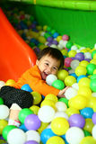 Playing baby. This is a baby girl. she is playing on the ball pond now. very happy Royalty Free Stock Photography