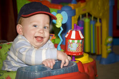 Playing baby. Baby boy playing with toys in nursery Royalty Free Stock Photos