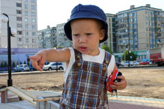Playing baby boy. Baby boy playing with toy auto in sand box Royalty Free Stock Photos
