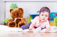 Playing baby in her room Stock Photography