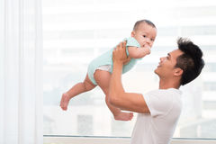 Playing with baby son Royalty Free Stock Photography
