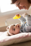 Playing with a baby Royalty Free Stock Photo
