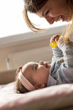 Playing with a baby Royalty Free Stock Image