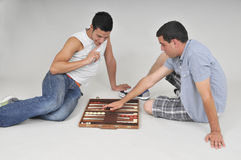 Playing backgammon Stock Photography