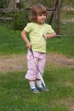 Playing badminton. Little, cute girl playing badminton outdoors on a summer day Royalty Free Stock Photo