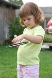 Playing badminton. Little, cute girl playing badminton outdoors on a summer day Stock Photo