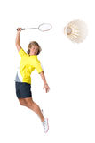 Playing badminton. Full isolated picture of a  caucasian woman playing badminton Royalty Free Stock Image