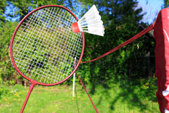 Playing badminton outdoors Stock Photo