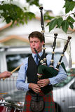 Playing the bag pipes. Royalty Free Stock Image