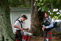 Playing the bag pipes. Stock Image