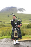 Playing bagpiper Stock Images